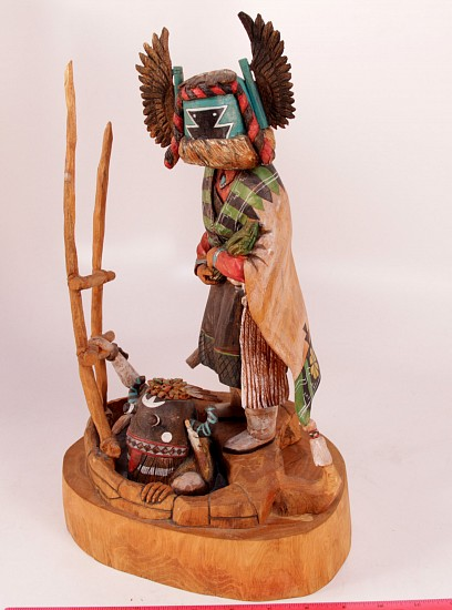 "05 - Kachinas and Dolls, Crow Mother Kachina and Whipper Kachina Emerging from Kiva 15"" height  x 9"" width by Raymond M. Chee 15.5"" ht 2004, Cottonwood root"